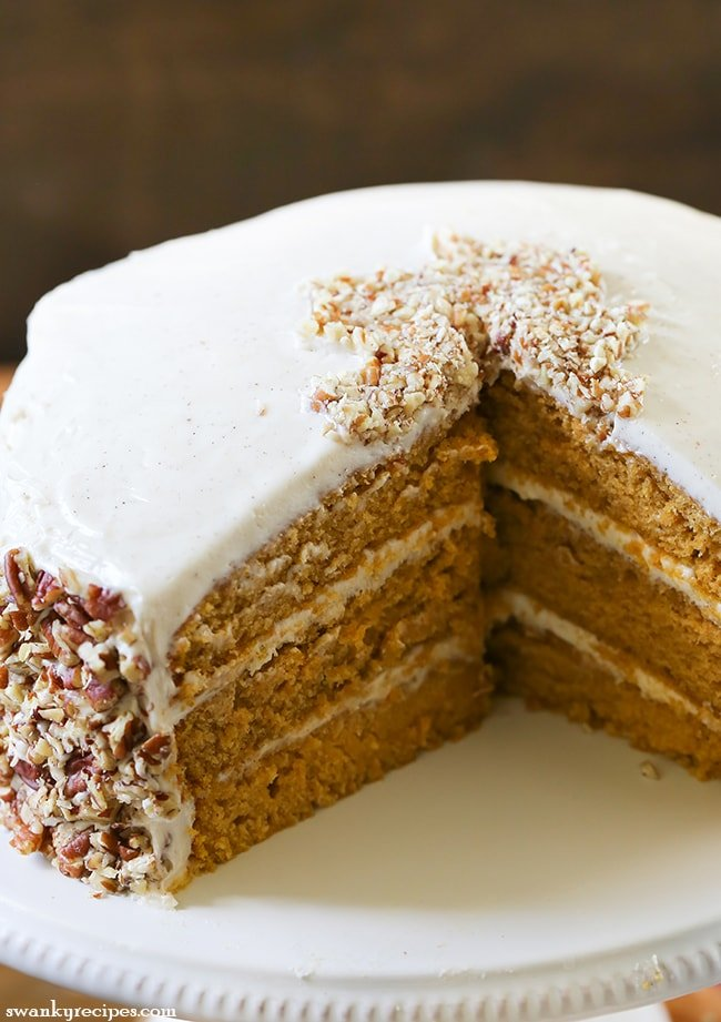Pumpkin Layer Cake - The best pumpkin cake with pecan cream cheese buttercream frosting. An easy dessert to serve for the holidays. #layercake #dessert #pumpkin