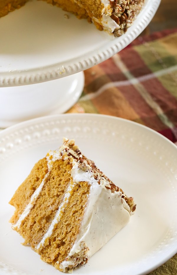Pumpkin Layer Cake - The best pumpkin cake with pecan cream cheese buttercream frosting. An easy dessert to serve for the holidays. #cake #recipe #holiday