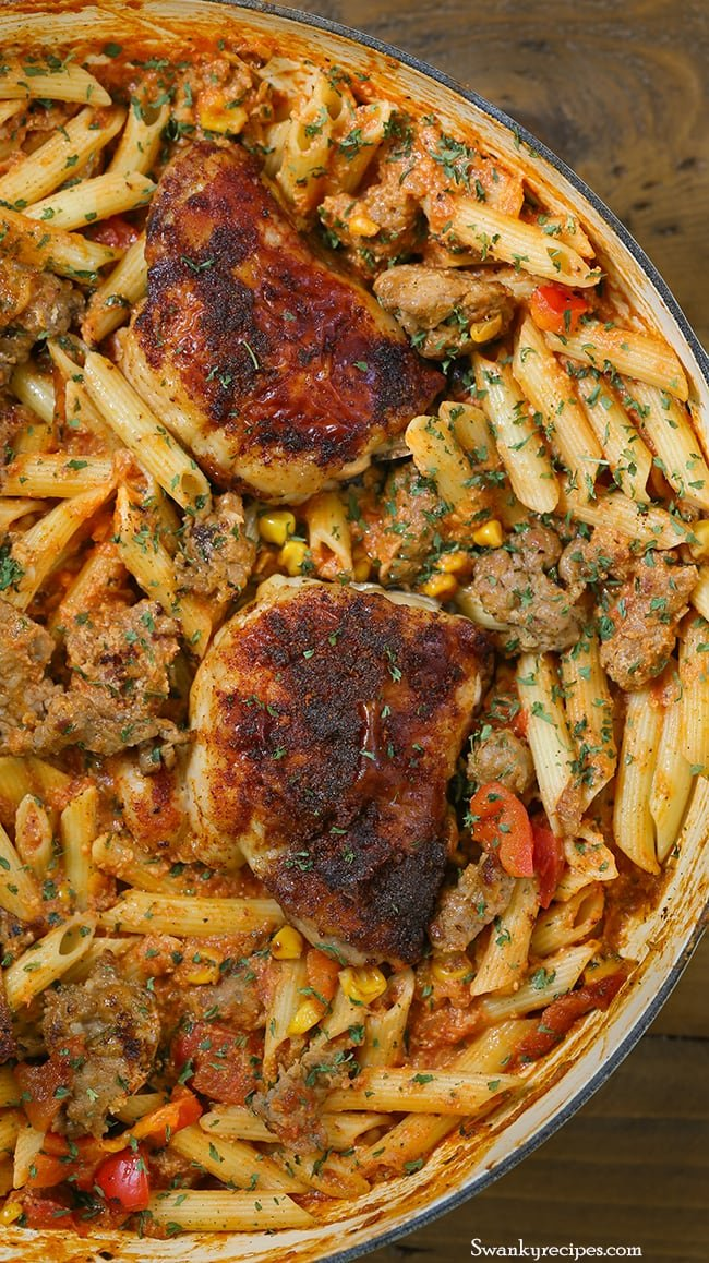 Roasted Red Pepper Brazilian Chicken and Chorizo Pasta - Easy oven-roasted Brazilian spiced chicken with fire roasted red peppers, charred corn and spicy chorizo sausage added to a rich and flavorful creamy marinara sauce with penne pasta. A homemade blend of spices added to this pasta gives it a robust Brazilian flavor everyone will love.
