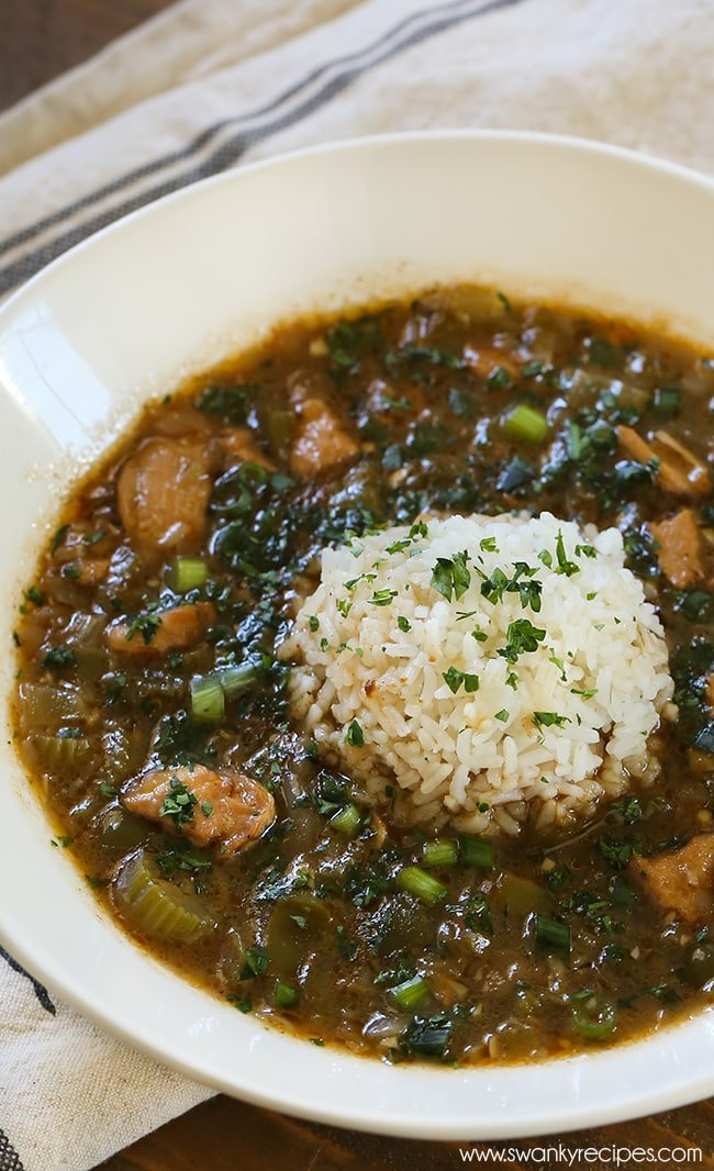 Easy Chicken Gumbo - The best New Orleans Gumbo made with a dark roux, chopped chicken and a trinity of traditional vegetables such as celery, onions, and green bell peppers. This classic dark roux is seasoned with Cajun seasoning and herbs that give it a classic gumbo taste you'll only find in southern Louisiana.