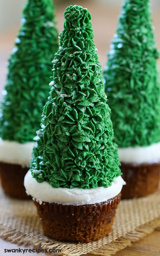 Easy Christmas Tree Cupcakes with gingerbread cake, snowy frosting and an ice cream cup decorated with frosting. These Christmas cupcakes are perfect for the holiday season and are a lot of fun to make. #cakedecorating #holidaybaking