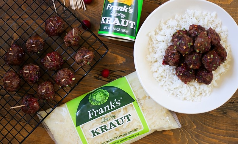 Slow Cooker Cranberry Meatballs - Homemade meatballs in a saucy sweet and spicy cranberry sauce. Serve these cocktail meatballs for the holidays. #appetizer