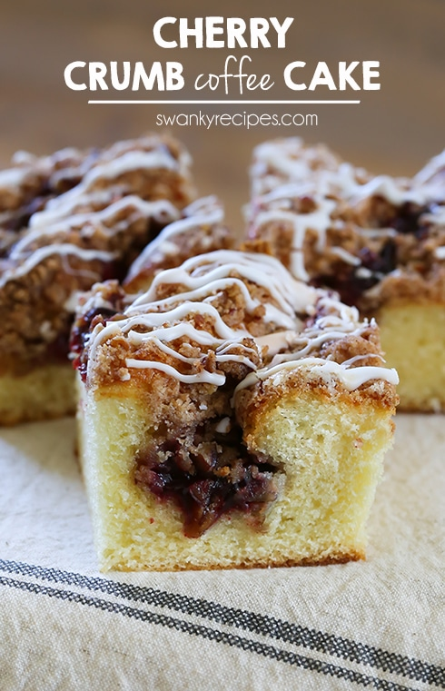 Cherry Crumb Coffee Cake - Moist Cherry Crumb Coffee Cake with pecan cherry pie filling, crumble topping and drizzled with icing.  This crumb cake tastes amazingly delicious served right out of the oven.  It's also a great way to use up any pie fillings you have stashed in the pantry.  #breakfast