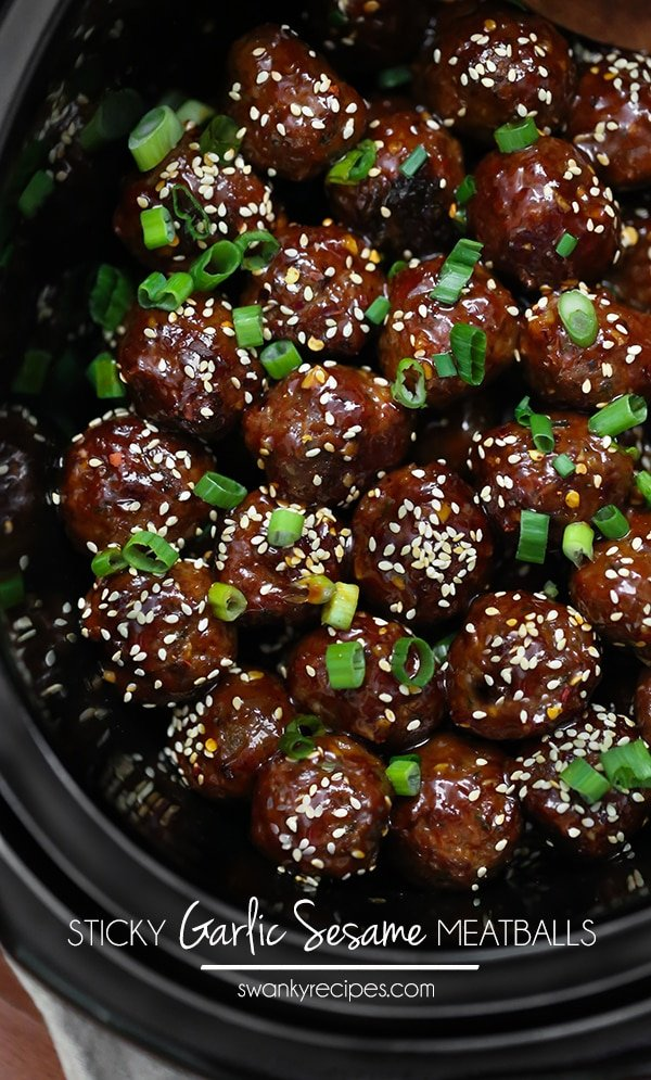 Garlic Sesame Meatballs - Savory Meatballs in a sticky garlic sesame sauce. This slow cooker recipe a family favorite. #slowcooker #meatballs #asianfood