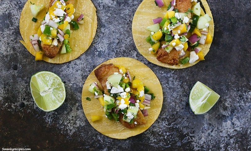 Fish Street Tacos - Crunchy street tacos made with crispy battered fish fillets and mango salsa.