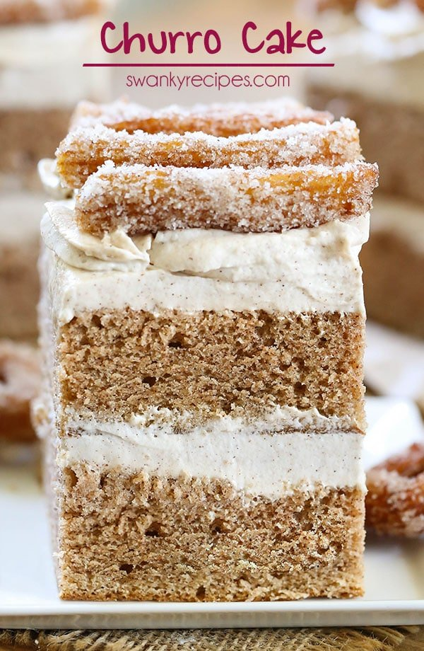 Churro Cake - Moist Mexican cinnamon butter cake with cream cheese buttercream frosting and churros. This decadent layer cake takes dessert to the next level!