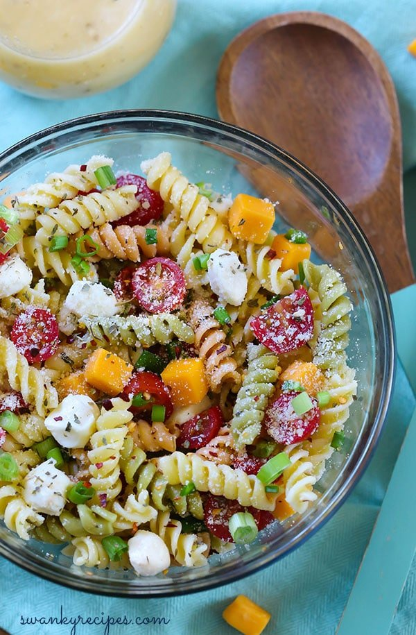 Easy Italian Pasta Salad - Hands down, the best summer pasta salad! Made with fresh vegetables, cheeses, and garden vegetable pasta! Serve for potlucks, barbecues, and summer parties! #Italian #pasta #potluck #vegetarian