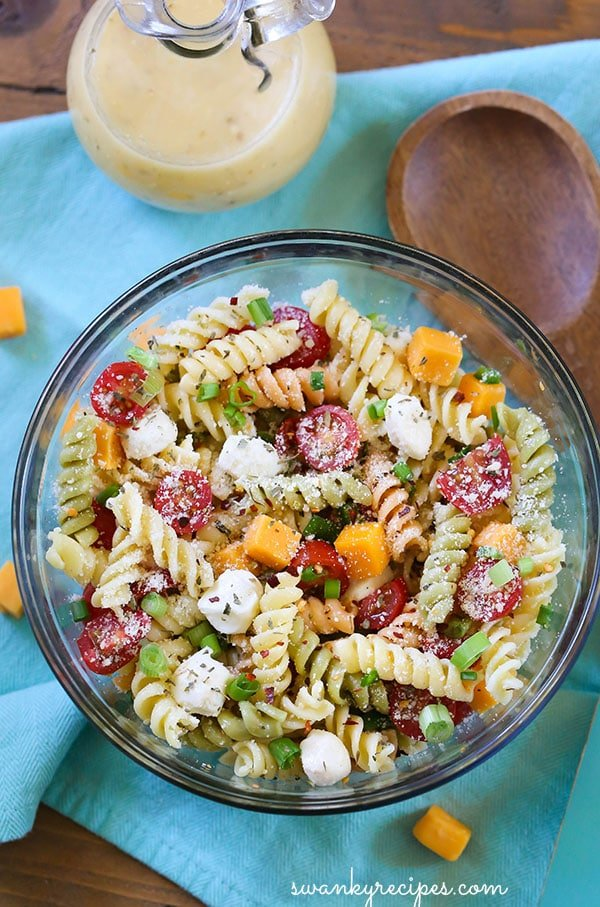 Easy Italian Pasta Salad - Hands down, the best summer pasta salad! Made with fresh vegetables, cheeses, and garden vegetable pasta! Serve for potlucks, barbecues, and summer parties!