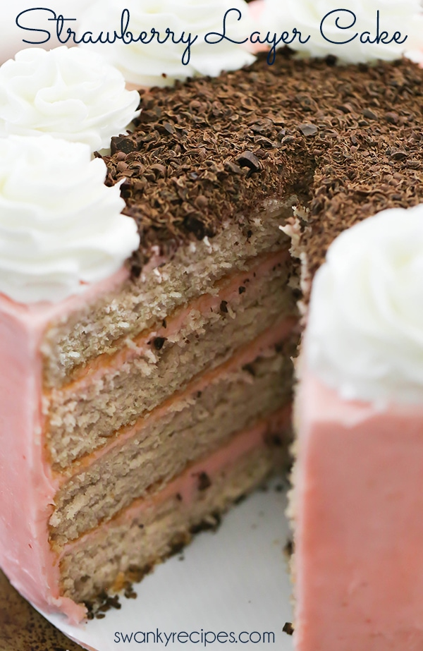 Strawberry Layer Cake - Hands down, the best fresh strawberry cake with moist crumb and slightly sweet cake layers between strawberry buttercream frosting. Everyone raves how delicious this cake is year round. Serve strawberry cake as a dessert during summer or as a birthday cake! #cake #buttercream #frosting