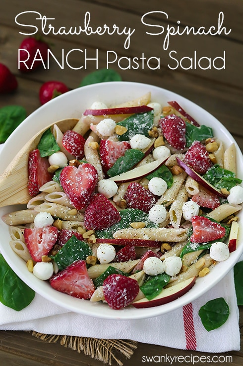 Ranch Pasta Salad with Strawberries and Spinach - Everyone raves that this is the best summer pasta salad to bring to potlucks, graduation parties, cookouts, and family reunions. This refreshing pasta salad is tossed with creamy ranch dressing for the perfect summer side dish. #pasta #ranch #strawberry #vegetarian