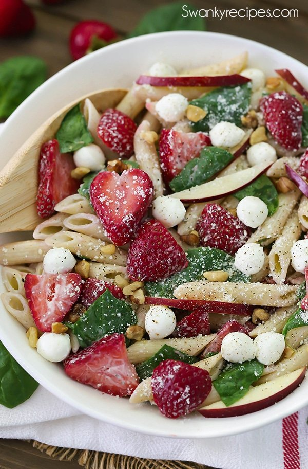 Strawberry Spinach Ranch Pasta Salad - Everyone raves that this is the best summer pasta salad to bring to potlucks, graduation parties, cookouts, and family reunions. This refreshing pasta salad is tossed with creamy ranch dressing for the perfect summer side dish. #pasta #ranch #appetizer
