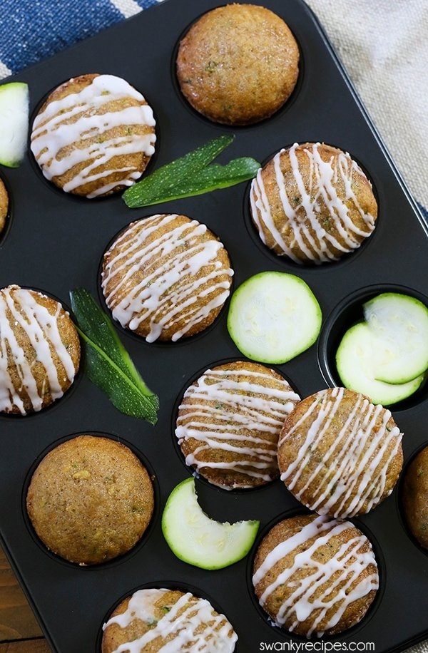 Zucchini Muffins - A super easy and quick recipe for zucchini muffins or zucchini bread. You'll love this end of summer healthier muffin! Made with summer zucchini from the garden.
