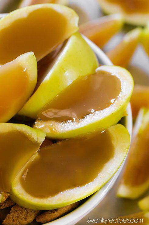 Caramel Apple Jello Shots - Boozy dessert jello shots. Apple cider, caramel vodka, caramel sauce, and gelatine fill apples. Friends always rave how fun these Caramel Apple Jello Shots are for a Halloween party!