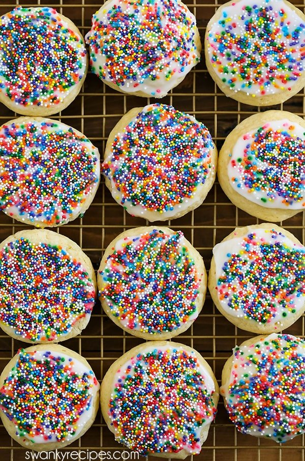 Italian Christmas Cookies - Quick and easy Italian sugar cookies. This Christmas cookie recipe doesn't require rolling the dough out on a floured surface. Made with an almond glaze and Christmas sprinkles.