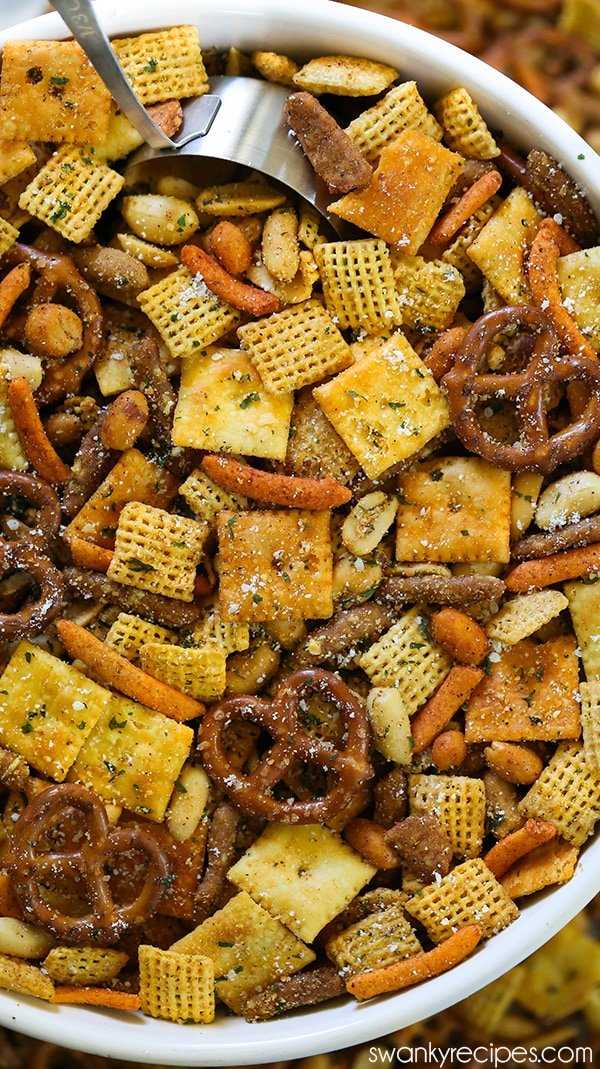 Cajun Chex Mix - For a taste of Cajun Country in Louisiana, try this spicy Cajun seasoning snack mix blend. Made with local Creole and Cajun seasoning from New Orleans, and pretzels, Cajun corn sticks, chex cereal, cheese crackers, and nuts. Everyone raves how amazing and easy this Chex Mix is for football parties, holiday parties and Christmas.