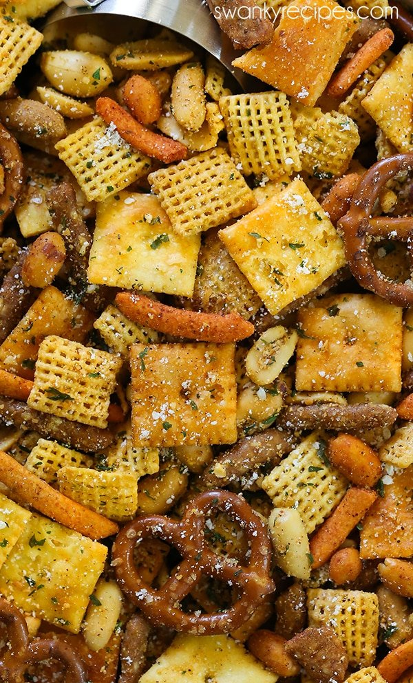 Cajun Chex Mix - For a taste of Cajun Country in Louisiana, try this spicy Cajun seasoning snack mix blend. Made with local Creole and Cajun seasoning from New Orleans, and pretzels, Cajun corn sticks, chex cereal, cheese crackers, and nuts. Everyone raves how amazing and easy this Chex Mix is. Perfect for the holiday season like Christmas and Thanksgiving.