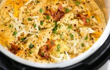 Instant Pot Crack Chicken - The BEST shredded chicken made in the pressure cooker with a creamy cheese sauce, ranch, and bacon.