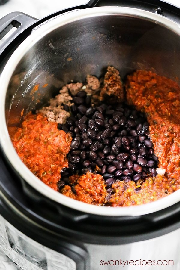 Instant Pot Taco Bowls - The pressure cooker is loaded with beef, beans, salsa, and rice. A one pot meal for a quick dinner.