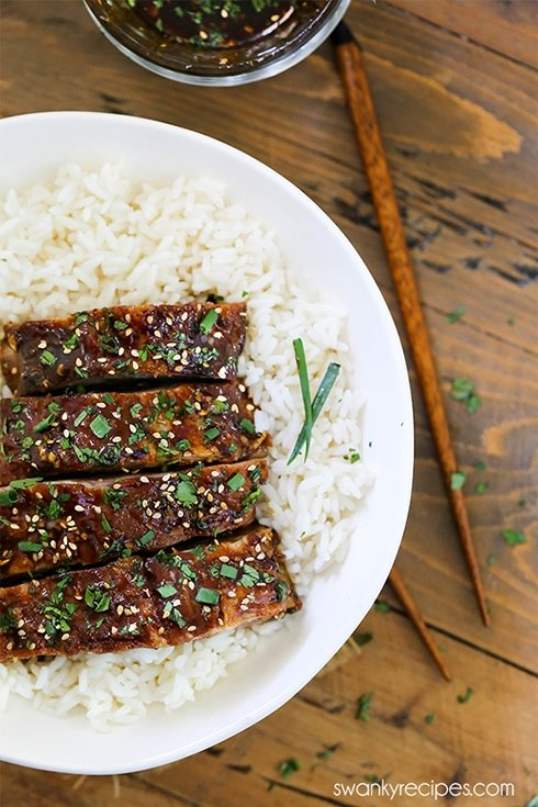Garlic Sesame Ribs served in bowl with a bed of white rice.
