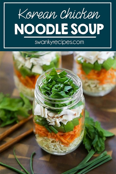 Instant ramen noodles in a mason jar with shredded carrots, celery, deli sliced chicken, celery leaves, green onions, and snow peas.