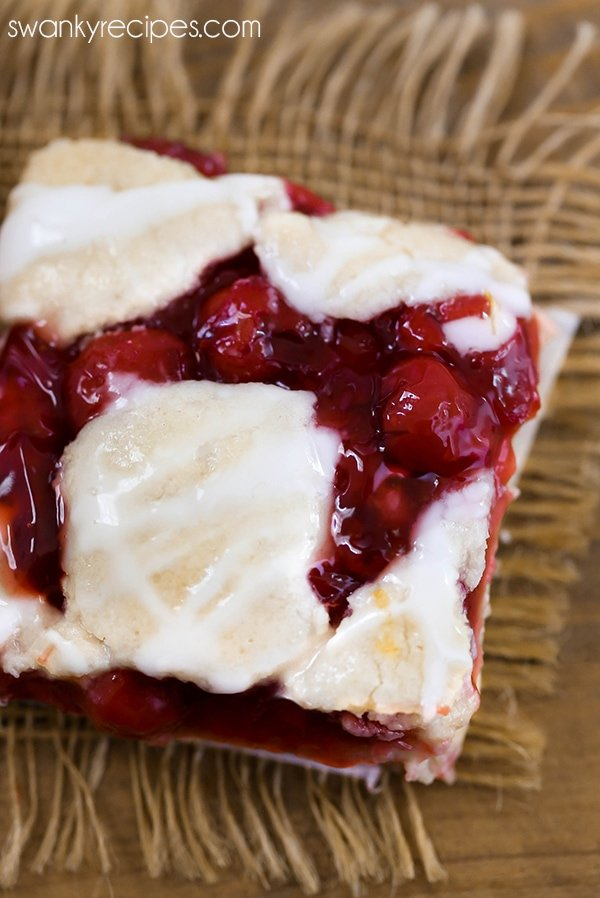 Cherry pie bar recipe with a crumbly pie crust top with cherry pie filling.