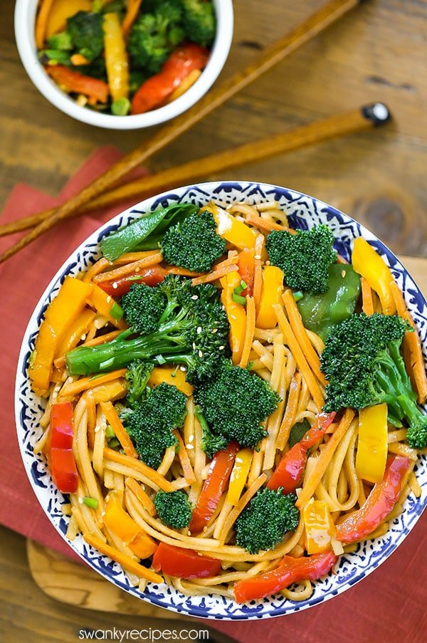 Quick Chinese stir fry with vegetables served in a bowl with chopsticks. Flavorful 15 minute Vegetable Lo Mein served as an Asian side dish or healthy Chinese dinner recipe.