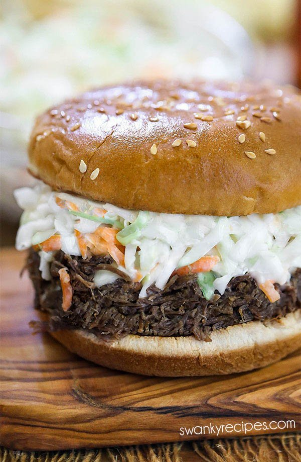 Instant Pot Pulled Pork with North Carolina Vinegar Sauce and slaw served on a sandwich bun. A quick pressure cooker pork dinner recipe.