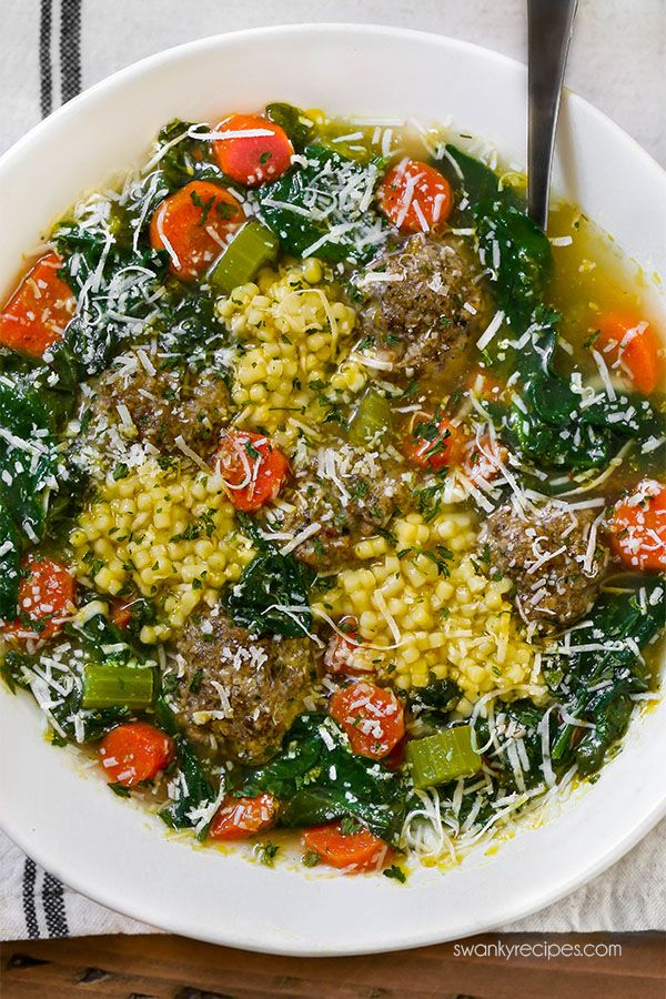 Italian Wedding Soup pasta with beef meatballs. Our family loves this chicken soup with vegetables and cheese.