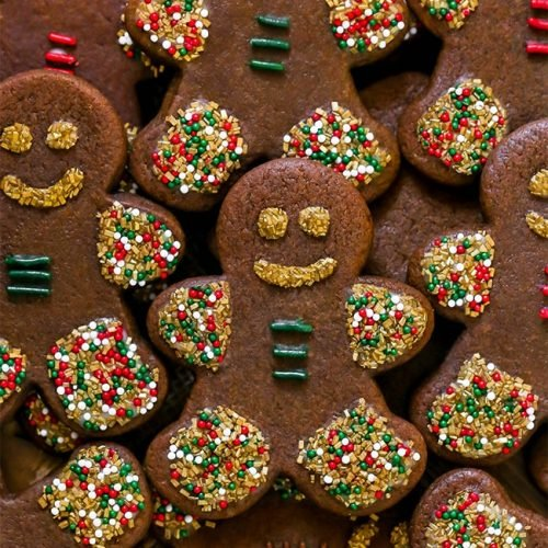 Chewy Gingerbread Men Cookies with sprinkles and icing served on a plate for Christmas.