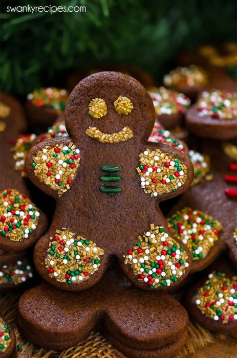 Soft Gingerbread Cookies. Thick and sturdy gingerbread man standing and decorated in glaze and sprinkles.