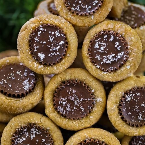 Master these iconic Peanut Butter Cup Cookies. EVERY cookie box needs to feature these peanut butter cookies stuffed with mini Reese's Peanut Butter Cups. These cookies bring out the child in everyone. Serving them on a cookie tray? Separate the variety of flavors by placing each cookie in a paper cupcake liner.