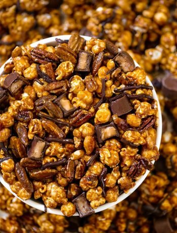 Golden caramel popcorn Moose Munch snack Mix served in a bowl for Christmas.