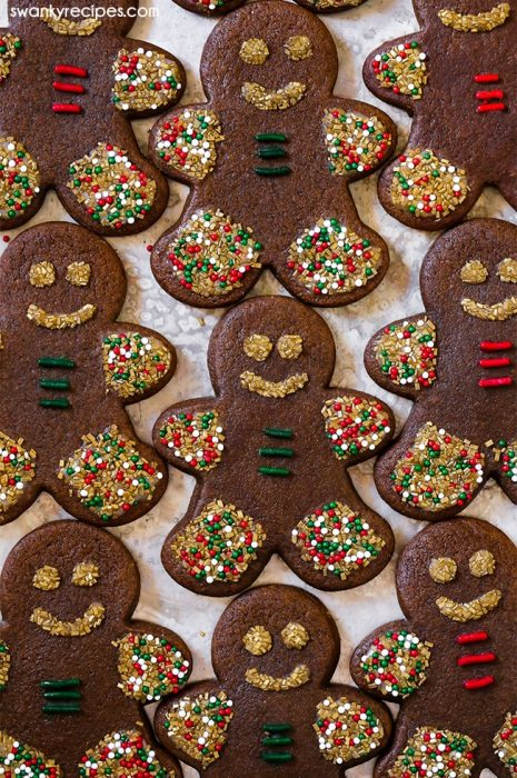 Gingerbread Cookie Cutouts rolled and bake in the oven. Iced and decorated with holiday sprinkles.