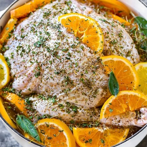 Turkey Brine Recipe - Whole turkey submerged in a basic wet brine solution of salt and water. An easy recipe with the addition of oranges, lemons, fresh herbs, dried poultry herbs for Thanksgiving.