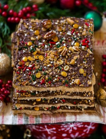 Christmas Cracker Toffee Candy with caramel filling and chocolate topping with sprinkles. Quick Christmas candy recipe.