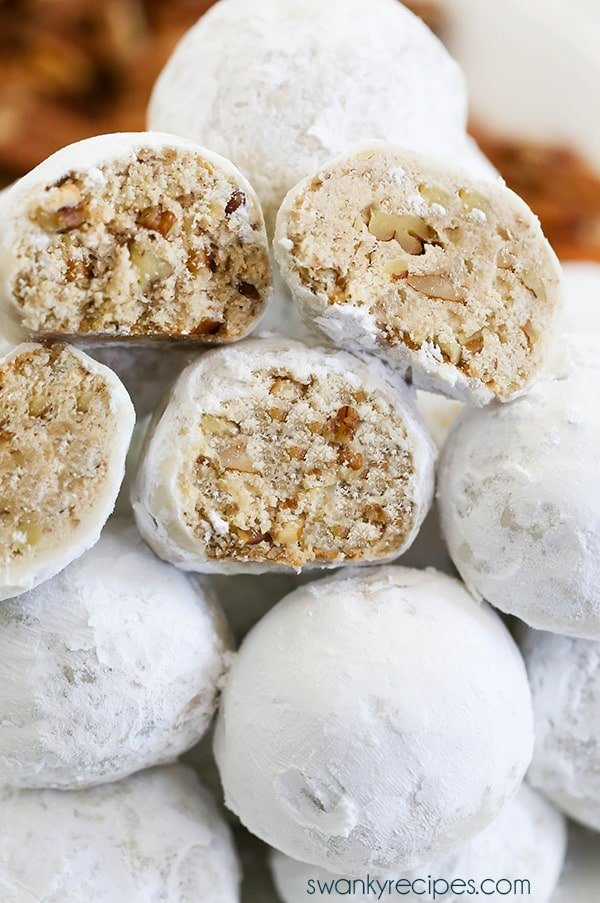 Perhaps the most iconic Christmas cookie is this Pecan Snowball recipe. Every Christmas party dessert table features dozens of these round shortbread cookies dusted in powdered sugar. They are so popular that dozens of countries around the world call them by names that include Pecan Shortbread Balls, Mexican Wedding Cookies, Russian Tea Cookies, Swedish Heirloom Cookies, Snowdrop Cookies, and English Tea Biscuits.