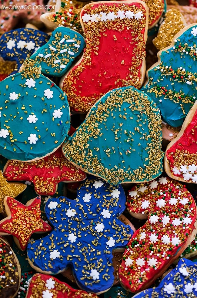 Rolled Sugar Cookie Cut Outs in traditional holiday shapes. Easy no spread cookie dough with icing and sprinkles.