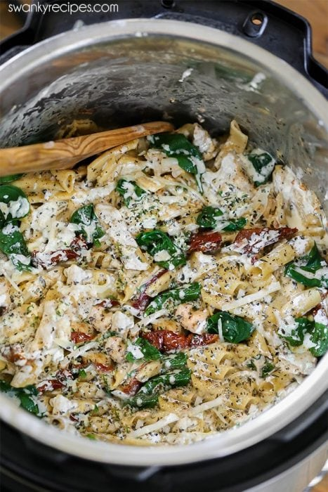 Instant Pot Chicken Pasta. Creamy Tuscan pasta with chicken breasts, pasta noodles, cheese, and herbs. A quick pressure cooker meal.