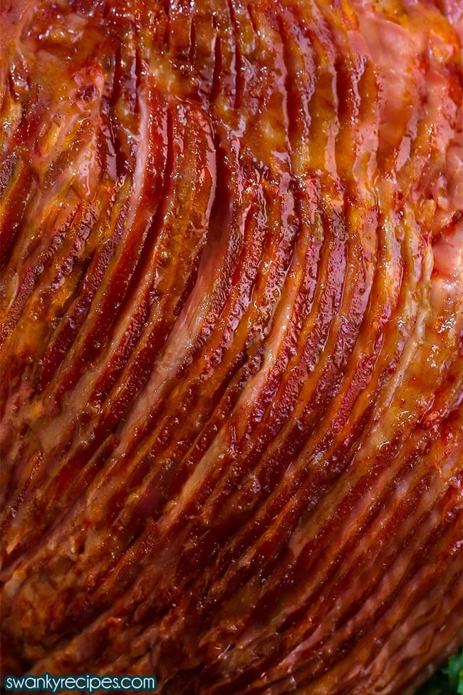 Easy baked honey ham recipe roasted in the oven and glazed in a honey sugar sauce.