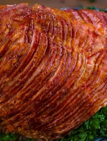 Honey Baked Ham - Juicy Baked Honey Ham recipe with a the signature HoneyBaked Ham sugar crust. Delicious oven-roasted spiral cut ham recipe for Easter dinner.