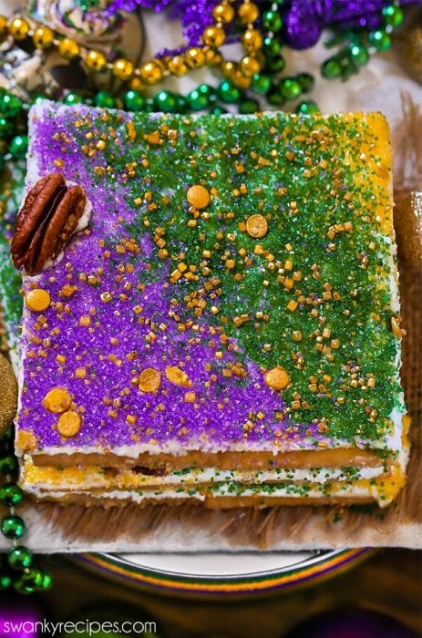 King Cake Candy made with saltine crackers, praline caramel, and king cake flavor frosting.