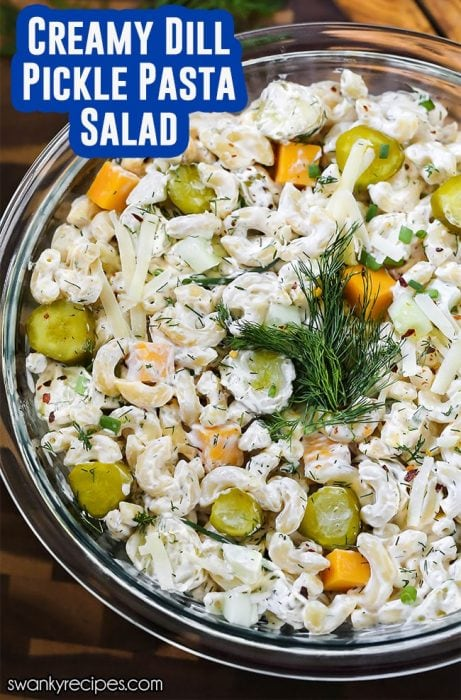 DILL PICKLE PASTA SALAD is a family favorite at all our spring and summer holidays. This creamy dill pickle salad is packed with cheese, pickles, and fresh dill. Serve it as a side dish next to sliced ham, fruit salad, and roasted broccoli.