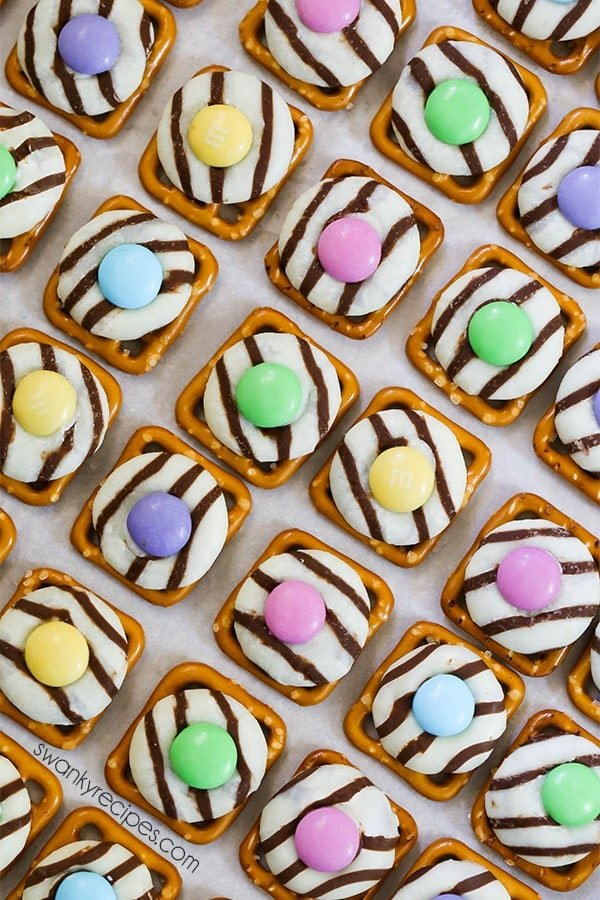 Fill Easter baskets will homemade candy this year. These EASTER PRETZEL HUGS WITH M&M'S use just 3 ingredients from start to finish. Even adults will love popping these in their mouths! The combination of sweet white chocolate and salty pretzels ranks this treat as a super easy and tasty one to make with the kids.