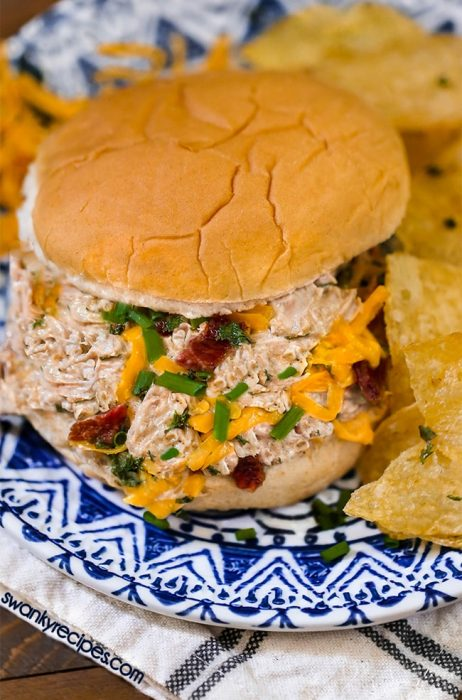 Instant Pot pulled pork in a delicious cheddar cheese sauce with ranch and bacon.