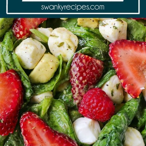 Strawberry Salad - Fresh spinach salad with strawberries, raspberries, avocado, and mozzarella cheese balls tossed in a simple homemade salad dressing of olive oil, balsamic vinegar, freshly squeezed lemon juice, and basil.