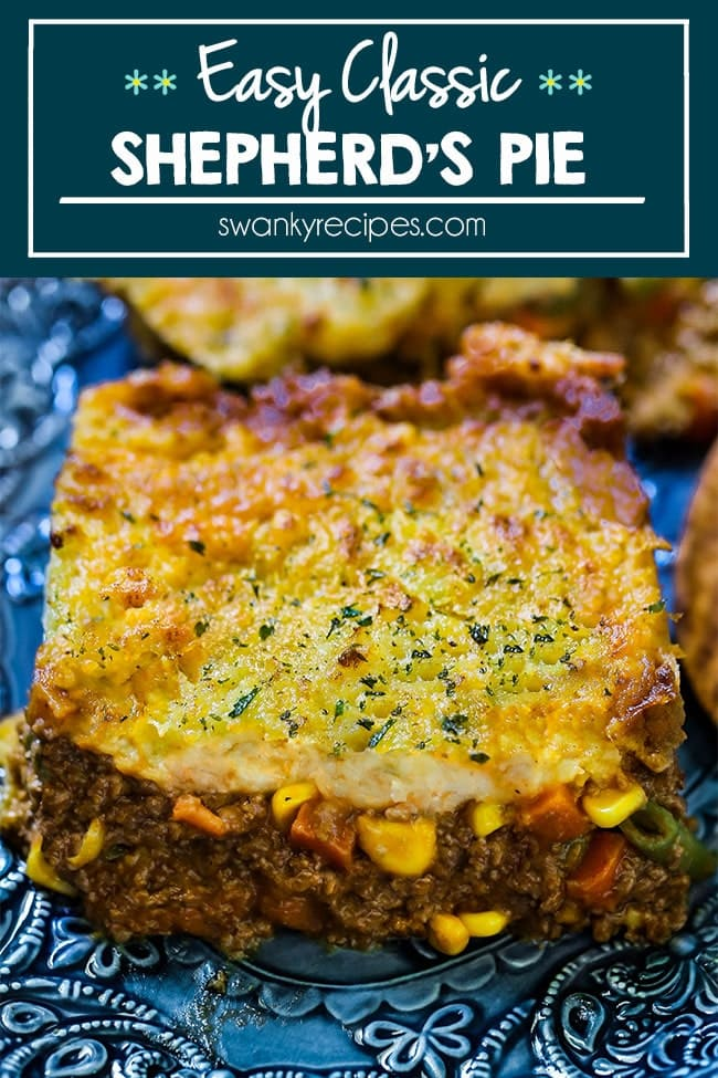 Classic Shepherd's Pie featuring a hot casserole dish with beef and vegetables in a red gravy sauce and mashed potatoes on top in a rustic dish.