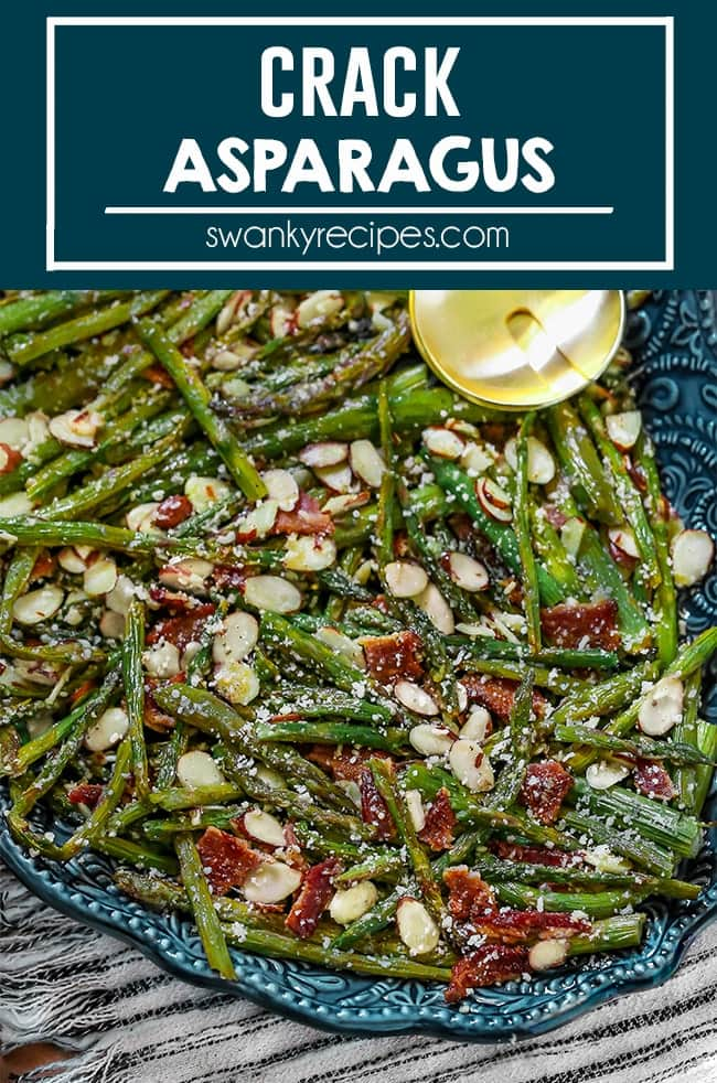 Roasted asparagus stalks garnished with almonds, bacon pieces, and grated parmesan cheese sprinkled on top. Served on a deep blue serving platter with two tone yellow and black serving set. Table spread with a black striped napkin with white and wooden table.