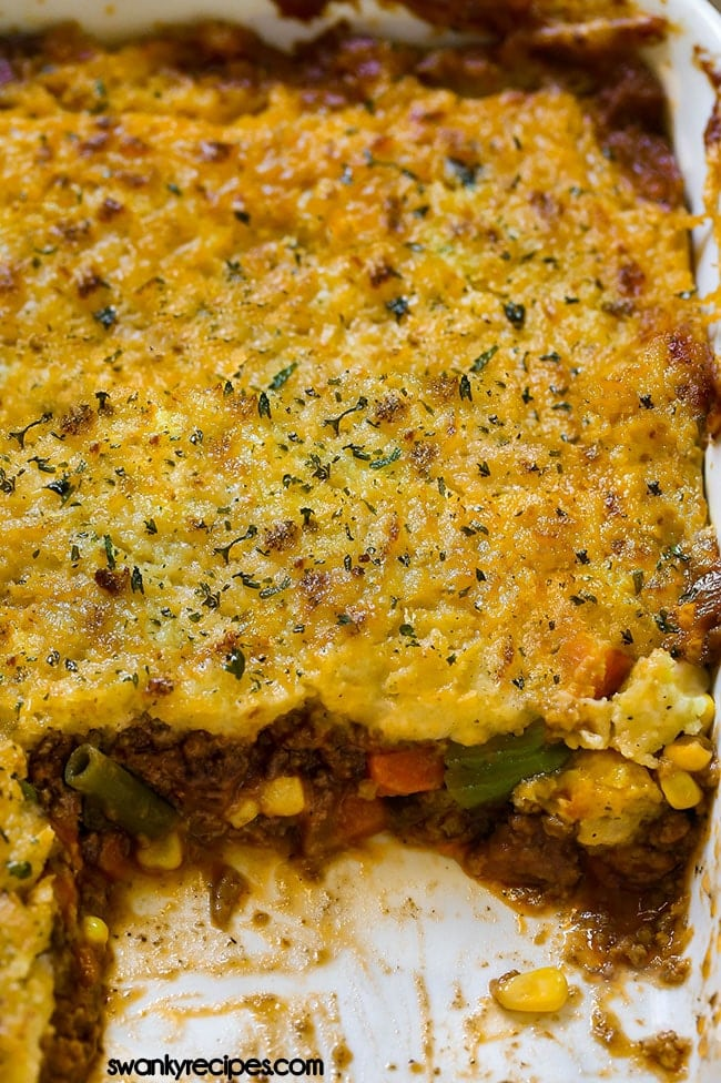 Ground Beef Shepherd's Pie. Browned ground beef simmered in a beef and tomato roux sauce with frozen vegetables. Baked in a casserole dish with creamy mashed potato crust.