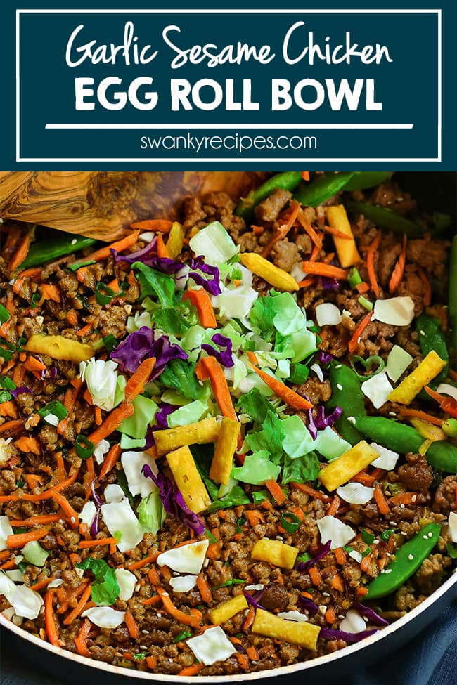 Egg roll ingredients in a skillet tossed together. Ground chicken minced in a brown sauce with fried wonton strips, snow peas, shredded red and green cabbage, lettuce.
