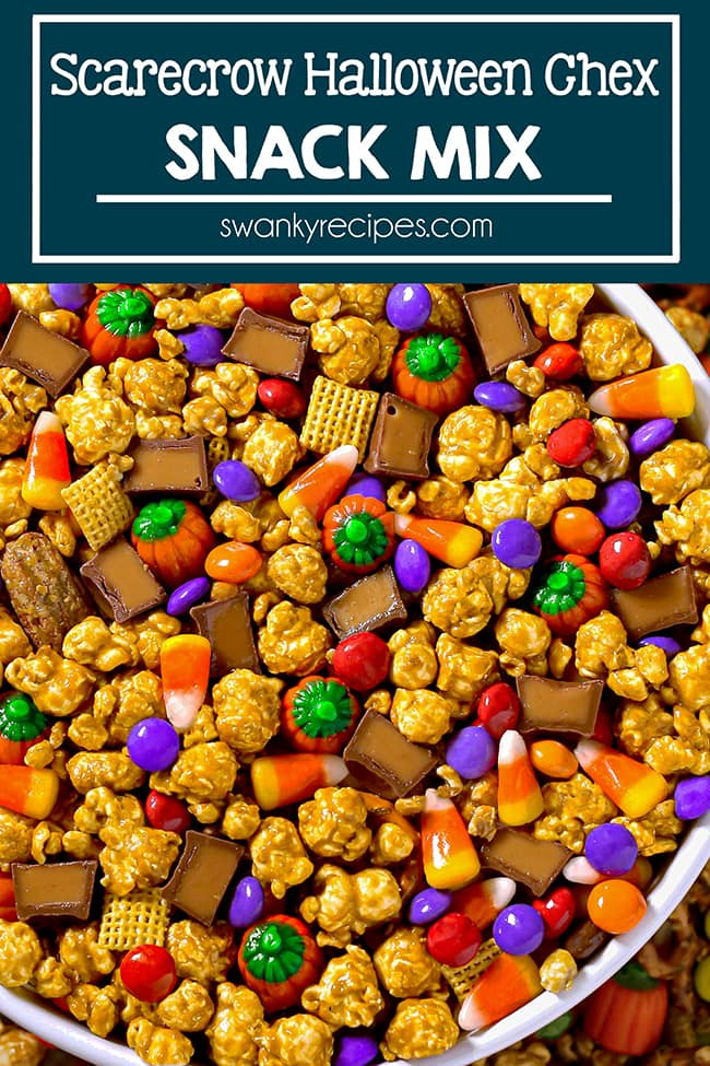 A white bowl filled with mostly caramel corn, Red, purple, orange, and brown M&Ms sprinkled throughout the bowl with orange and green pumpkins, classic candy corn, and yellow chex mix.